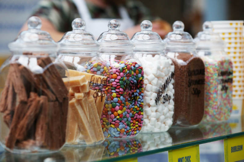 Decorative shot of jars of ice cream sprinkles on the cabinet at Rays Ice Cream