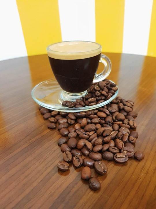 Fresh espresso coffee with decorative coffee beans around, at Rays Ice Cream